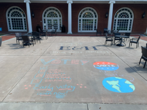 Civic Leader Scholars working on the Get Out the Vote campaign drew informational graphics about voting in front of Van Dyke Hall to promote their campaign.