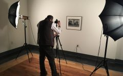Joe Champagne photographs a piece for the online permanent collection.