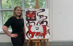 Junior Art major Sarah Thomas and one of her pieces from her art show entitled Therapy Session